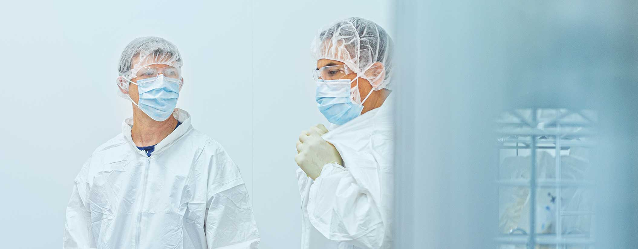Two scientists in lab coats